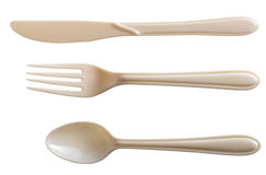 White plastic fork n spoon. Off white set off plastic knife, spoon and fork isolated on white background Stock Photography