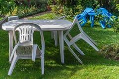 White plastic furniture garden chair table children kids lawn Stock Photography
