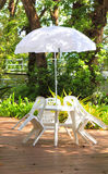 White plastic garden furniture table and chairs summer evening - Stock Image