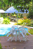 White plastic garden furniture table and chairs summer evening - Stock Photo