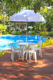 White plastic garden furniture table and chairs summer evening - Royalty Free Stock Photos