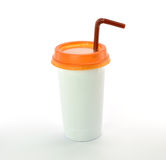 White plastic glass orange cap with straw on white background Royalty Free Stock Images