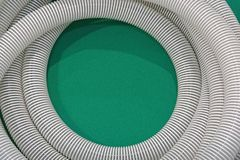 Hose coil. White plastic hose coil spiral Stock Photography