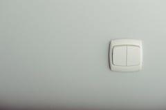 White plastic light switch Royalty Free Stock Photos