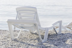 White plastic loungers to relax on beach Stock Image