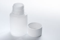 White plastic medical container bottle, on gray background Stock Photography