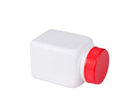 White plastic medical container with red cap on white background Royalty Free Stock Photography