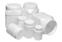White plastic medical containers for pills and capsules Royalty Free Stock Images