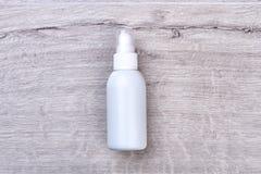 White plastic moisturizer bottle. Stock Photography