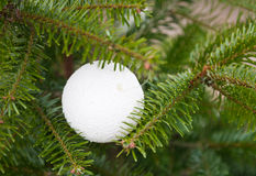 White plastic ornament on Christmas tree Royalty Free Stock Images