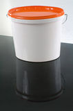 White plastic painter container with orange cap - mockup Royalty Free Stock Image