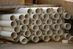 White Plastic Pipes. Piled white plastic pvc pipes at a construction site royalty free stock image