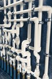White plastic pipes in boiler room Royalty Free Stock Images