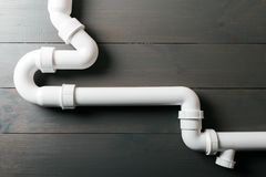 White plastic sewerage water pipes Royalty Free Stock Image