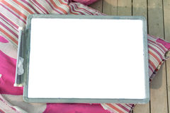 White plastic whiteboard on a pink pillow Stock Images