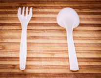 White plastic spoon and fork. Stock Photos