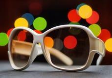 White plastic sunglasses. Funny bokeh Stock Image
