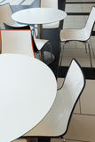 White plastic tables and chairs in cafe Royalty Free Stock Photography