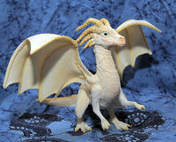 White plastic toy dragon Stock Images