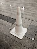 White plastic Traffic cone on a stone block floor royalty free stock photos