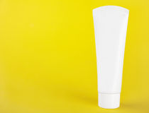 White plastic tube without labels, containers for cream or tooth Stock Image