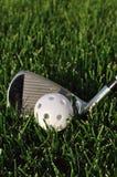 White Plastic Wiffle Ball and Golf Club Stock Photos