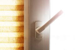 White plastic window or door detail with handle so close stock images