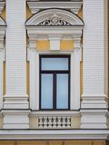 White plastic window made in a classic style royalty free stock images