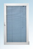 White plastic window with a sloping and two glasses and blue color blinds Royalty Free Stock Photography