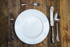 White plate with antique cutlery Stock Images