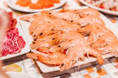 White plate with assorted prawns on a table for Christmas stock photos