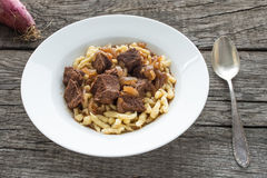 White plate of beef goulash Royalty Free Stock Photos
