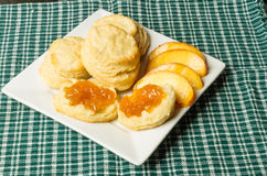White plate with biscuits and peaches Stock Images
