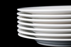 White plate on black background Stock Image