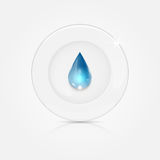 White plate and blue drop. Dishwashing liquid on a background dish Stock Photos