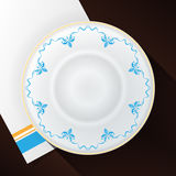 White plate with a blue pattern. Stock Images