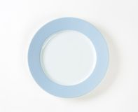 White plate with blue rim Royalty Free Stock Photography