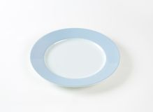 White plate with blue rim Royalty Free Stock Images