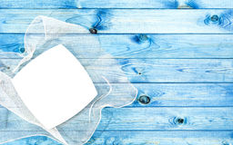 White plate on blue table. Blue wood board texture Stock Photography