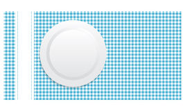 White plate on blue tablecloth Royalty Free Stock Photography