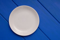 White plate is on blue stock image