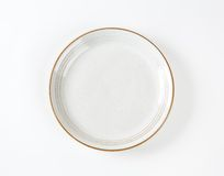 White plate with brown rim Stock Photo