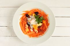 White plate with carrot salad Stock Images