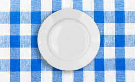 White plate on checked fabric tablecloth Royalty Free Stock Image