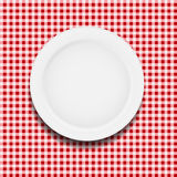 White plate on a checkered tablecloth vector Royalty Free Stock Photography