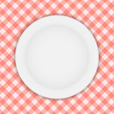 White Plate on a Checkered Tablecloth Vector Stock Image