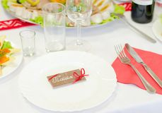 White plate with chocolate card. On a table Stock Image