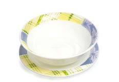 White plate with color ornament Royalty Free Stock Photography