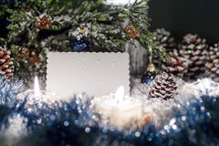 White plate for congratulations is near the Christmas tree. Christmas still life is with snow. White plate for congratulations is near the Christmas tree Stock Photos