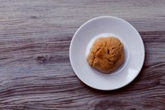 A white plate with a cookie stock photography